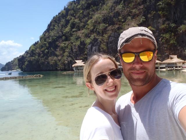 {honeymooners in front of the resort}